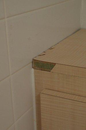Holiday Inn Express Shrewsbury: Bathroom decor panels damaged, split and swollen with water