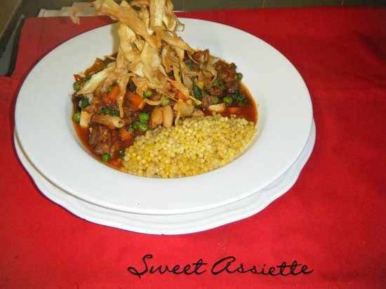 Sweet Assiette Restaurant: Slow braised Tuscan style lamb w'kalamata olives on preserved lemon cous cous