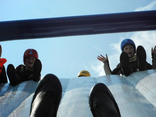 Galloway Activity Centre: Alex and Barnaby watching me going down the wobbly slide.