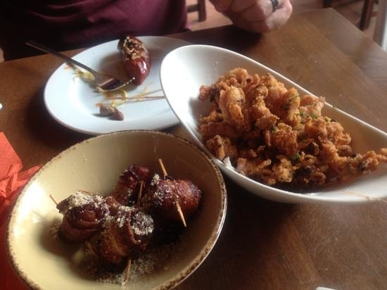 Volver: bacon wrapped dates, chorizo and fried calamari