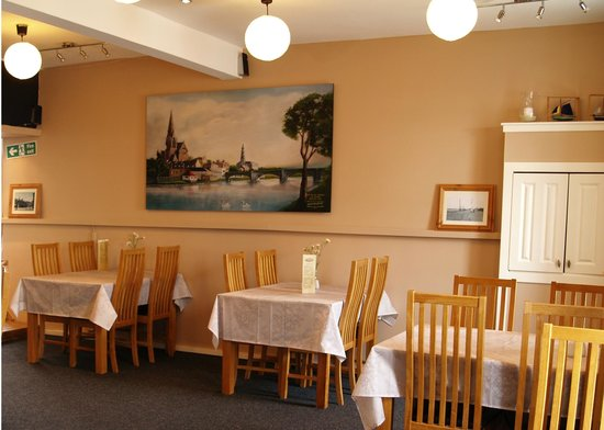 Old Town Cafe: Inside our cosy cafe with a view of the old town