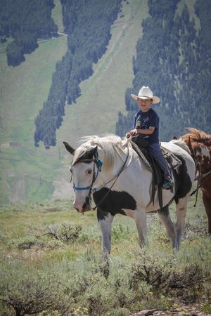 """Spring Creek Riding Stables: My 5 year old on his gentle horse """"Dollar"""".  Notice the amazing view!"""