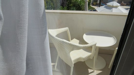 The Charm of Cascais: small balcony with table and chairs overlooking pool