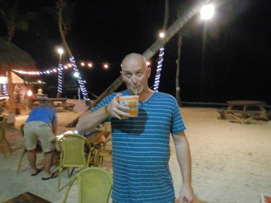 Iggies Beach Bar & Grill : My hubby drinking his voodoo juice