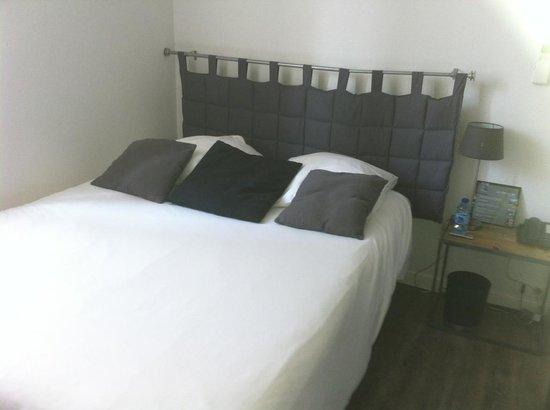 Un Hotel en Ville : lit