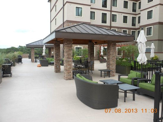 Staybridge Suites Stone Oak: Outdoor area and two weber grills on left side