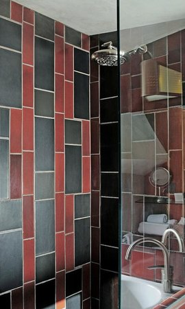 Hotel Lautner: Heath Ceramic Tiles and Rain Shower Heads in Each Bathroom