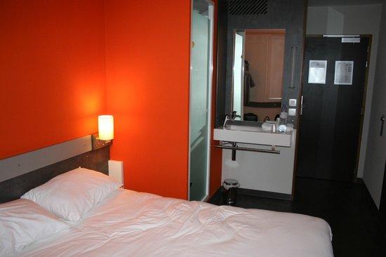 Ibis Budget Archamps Porte de Geneve: In room sink and shower on left. Looking toward door