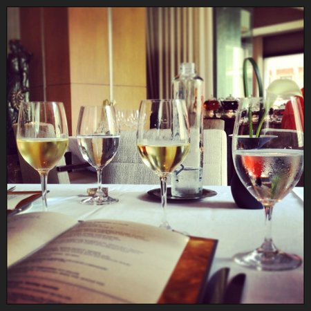 L'Espalier : View of our table. . wine. . water. . . ordering something delicious next.