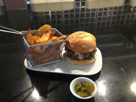 The Rare Cow: Our 10oz Burger with Triple cooked Chips Made from the finest steak Minced with onion and season