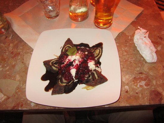 Redolfi : Pancake with chocolate and raspberry sauce.