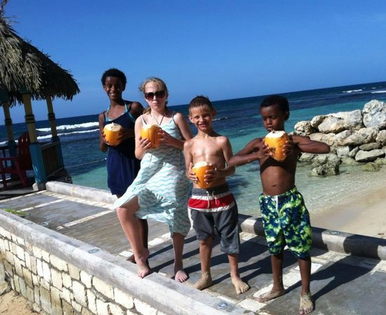 Hermosa Cove - Jamaica's Villa Hotel : Four of our kids on the beach with coconuts fresh-picked by Elvis.