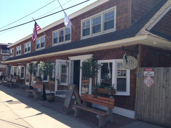 CJ's Restaurant & Bar: Exterior of CJ's located right on Bay Walk across from the ferry!