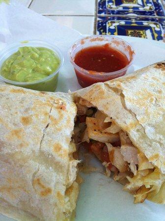 El Super Burrito: The super quesadilla is a traditional quesadilla rolled like a burrito, then grilled.
