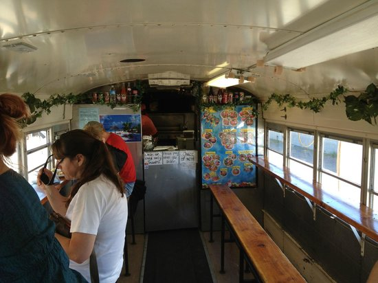 Taqueria Las Palmitas: bench seating and ordering inside the Taco Bus