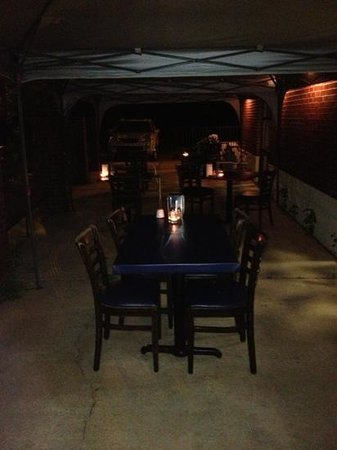 Moustache Cafe: outside patio at Moustache with candle light, come and have a romantic dinner