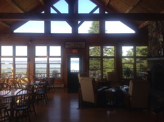 9th Wave Lodge: Lodge water view with stone fireplace
