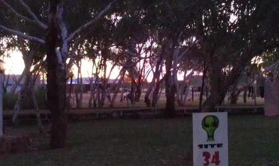 Wycliffe Well Holiday Park : Sunset over the back of the caravan park area looking through an unoccupied unpowered site