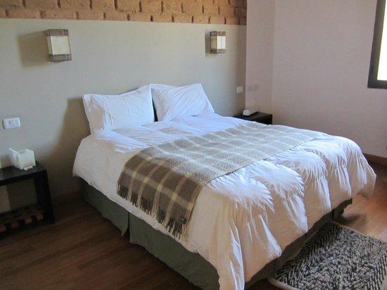 Hosteria De Altura El Penon: dormitorio con cómodo sommier