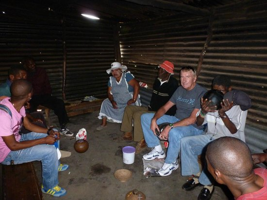 Soweto Bicycle Tours: Sharing corn beer in a shebeen with the local residents