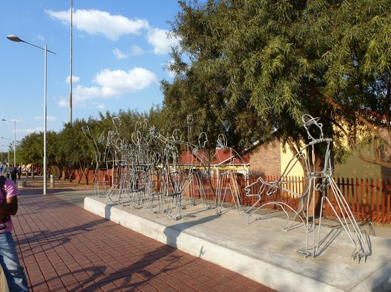 Soweto Bicycle Tours: Meadowlands scuplture depicting police dogs starting to attack students in 1976 uprising.
