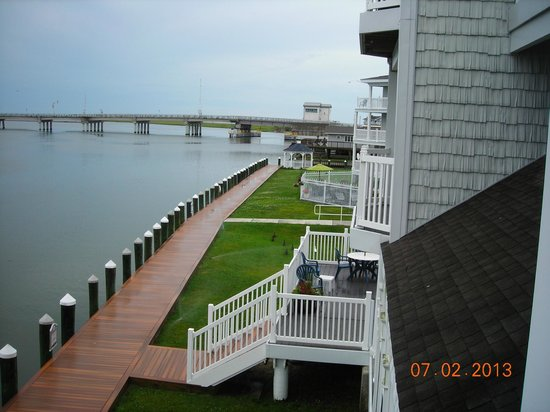 Comfort Suites Chincoteague: view off balcony of grounds near outdoor pook & causeway to mainland