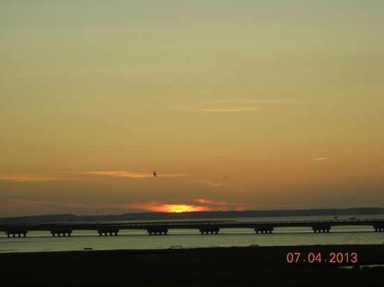 Comfort Suites Chincoteague: view off balcony of sunset beyond causeway to mainland
