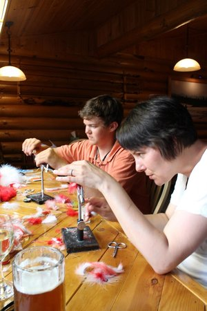 Alaska Fishing Lodge - Wilderness Place Lodge: Tying flies with our guide, Matt