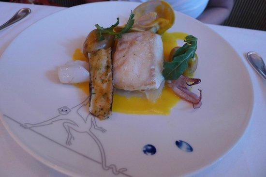 Le Cirque: Wild Halibut grantinee clams, calamari, cipolline onion marmalade, peanut potatoes, saffron