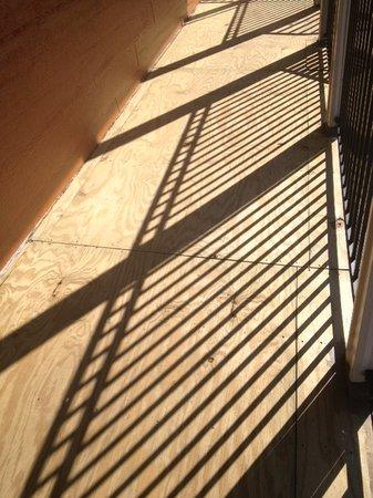 Deadwood Station Bunkhouse & Gambling Hall: Plywood floor on balcony walkway.