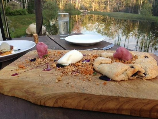 Earth : Blueberry Galette served on wooden board at our table