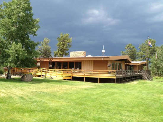 The Nature Place: Main Lodge at TNP - July afternoon, just a thunderstorm rolled in over the mountains