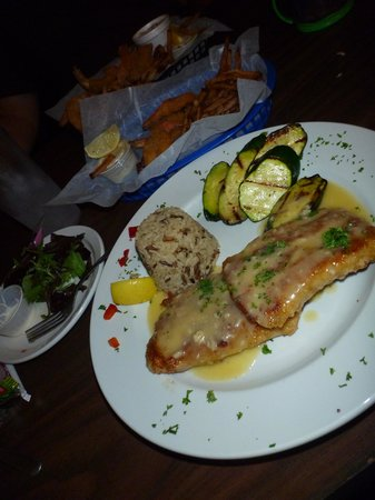 Kody's Restaurant and Bar : My fish dinner- looked pretty, sooo dry.  Veggies and rice were fine.