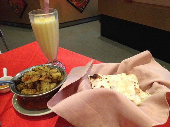 Tandoori Palace: Delicious mango lassie with my curry.