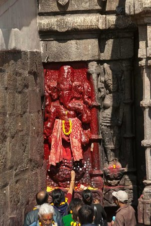 Kamakhya Temple : People sticking coin on statue