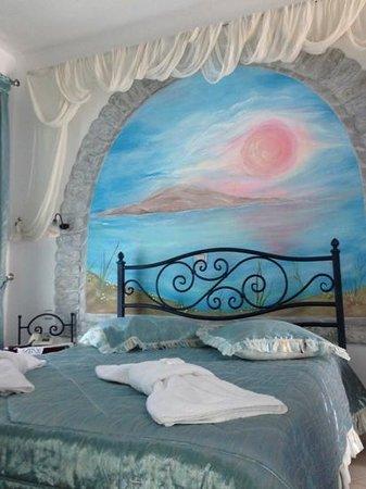 Amaryllis Apartment Studios : camera da letto