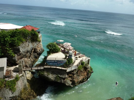 "Ungasan, Indonesien: Surfers heading out through the ""whole in the wall""."