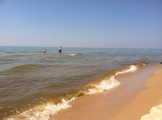 Hoffmaster State Park: my 2 favorite guys wading in Lake Michigan