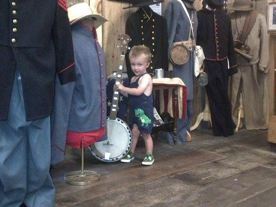 Civil War Living History Museum: Lil Hunter Checking Out Banjo on Display