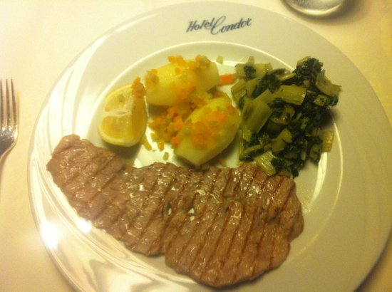 Hotel Condor: grilled veal steak with buttery kale and small roasted potatoes