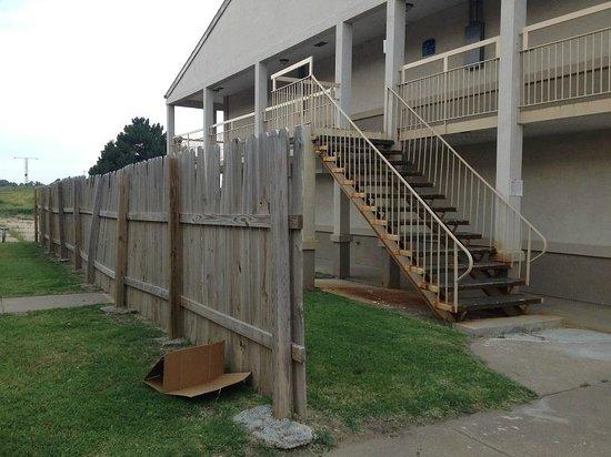 Knights Inn Salina : Exterior of Hotel, fence to hide derelict motel next door