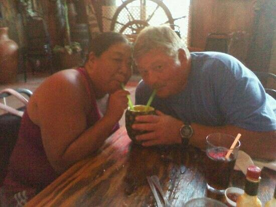Moby Dick's: friends sharing a piña colada (served in whole pineapple)