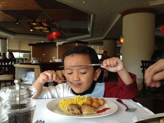Aryaduta Bandung: son enjoying his breakfast meal