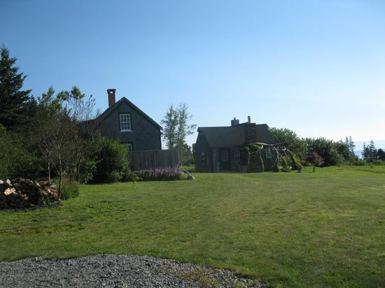 Inn at Whale Cove Cottages: Coopershop cottage on left with the larger Orchardside on right