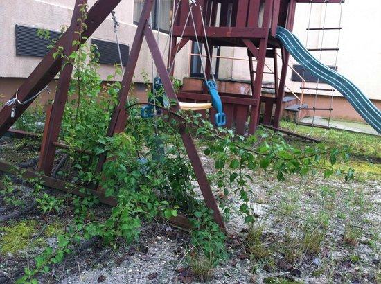 Oh St Joseph Resort Hotel: Playground equipment overrun with weeds