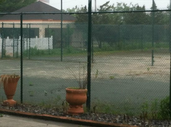 Oh St Joseph Resort Hotel : Outside tennis courts - or what's left of them.