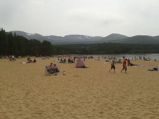 Silverglades Holiday Homes : Beach at Loch Morlich . Still snow on mountains ,July 2013