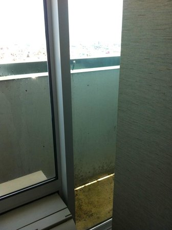 """Atlantic Sands Hotel & Conference Center : Our metal-lined """"balcony"""""""