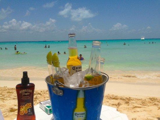 Playa Norte: Playa del Norte Beach and Corona ice buckets.