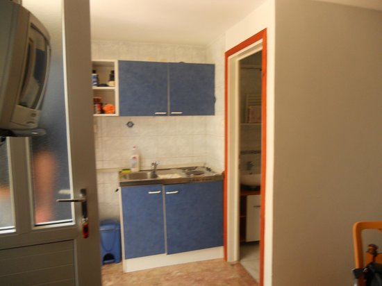 Peric Rooms and Apartments: kitchen to the left of the door